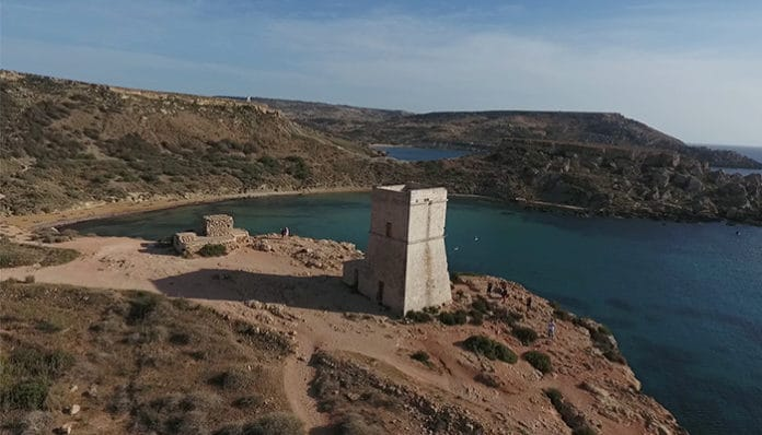 drone shot ghajn tuffieha tower malta