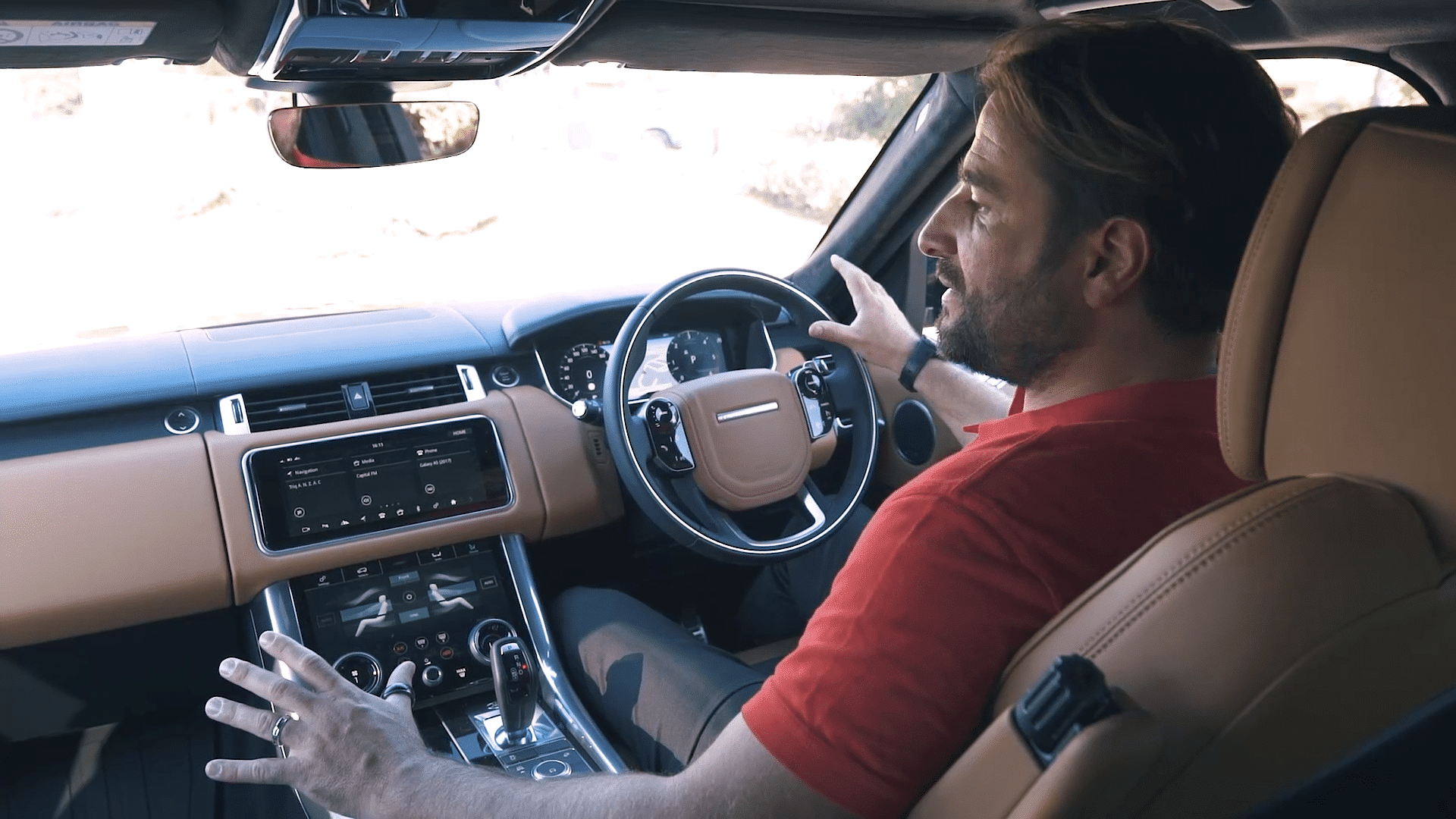 Ian showing off the Range Rovers dashboard